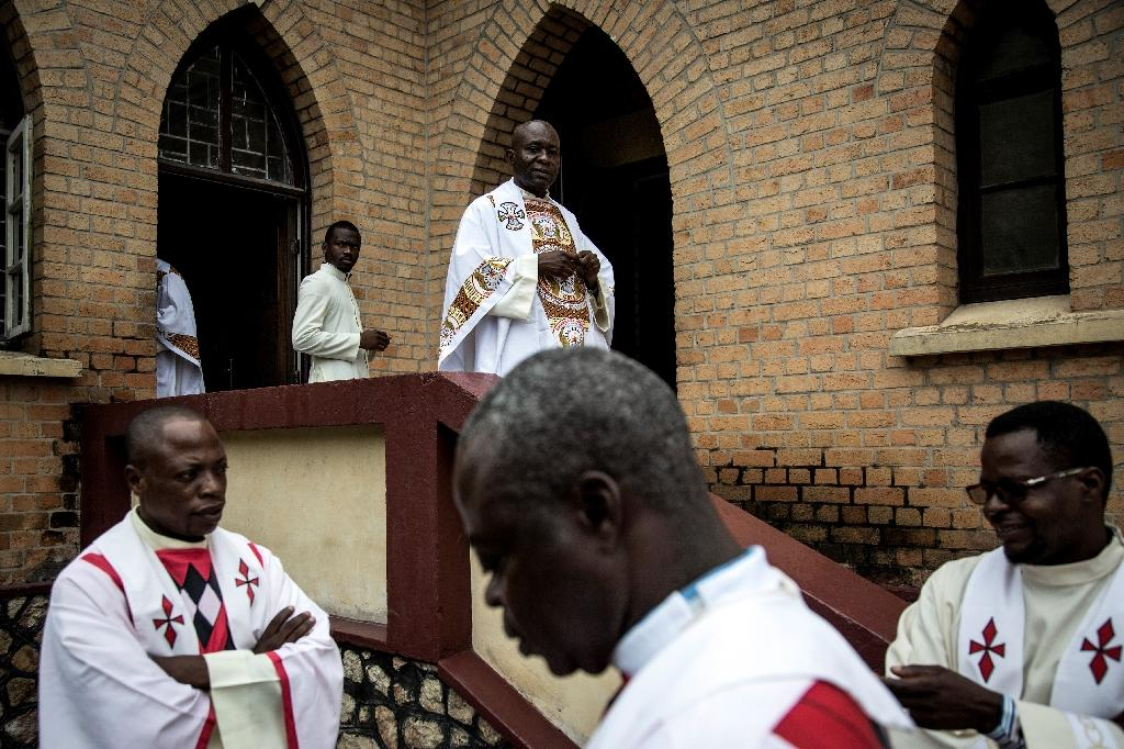 Catholic priests preparing to celebrate Independence Day martyrs last January in a country where most profess various forms of Christian faith and where the church exercises strong influence (AFP Photo/JOHN WESSELS)