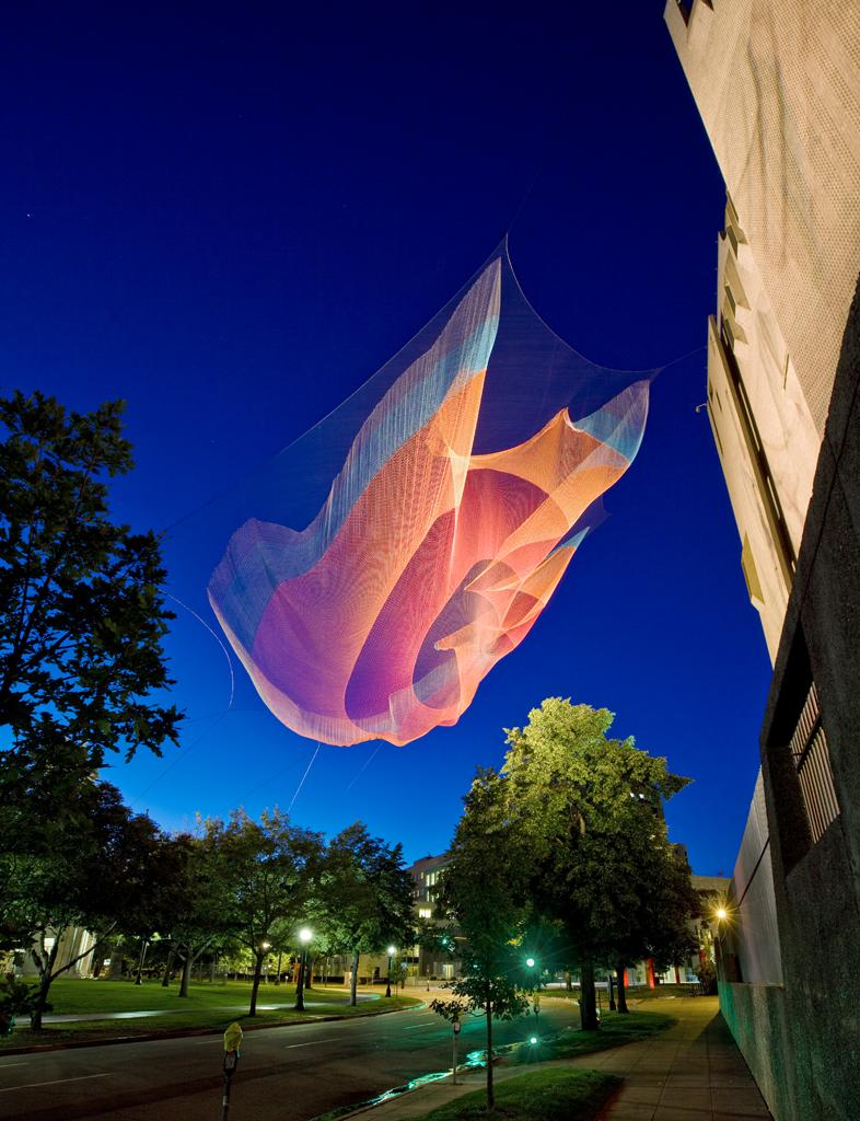 Acclaimed artist Janet Echelman builds massive urban sculpture environments that respond to their surroundings . As the sculptures shift with the wind, they give the appearance of being alive. This temporary piece was installed in Civic Center Park in Denver, Colorado for the Biennial of the Americas. (Photo: Peter Vanderwarker)