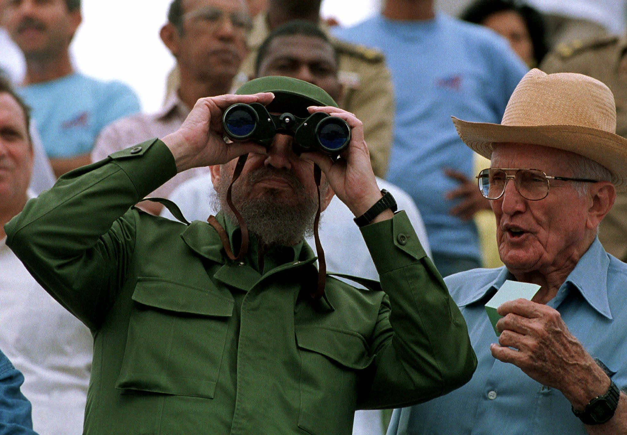 FILE - In this May 1, 1999 file photo, Vice President Jose Ramon Fernandez, right, stands with Cuban leader Fidel Castro who watches May Day festivities at Revolution Plaza in Havana, Cuba. Fernandez, a career soldier who joined Cuba's 1950s Revolution and became a prominent collaborator with the Castro brothers, died on Sunday, Jan. 6, 2019, according to official media. He was 95. (AP photo/Jose Goitia, File)