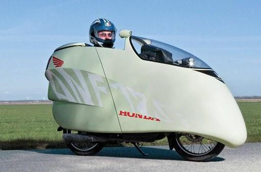 125cc motorcycle + DIY fiberglass fairing = 214mpg, super cool looks