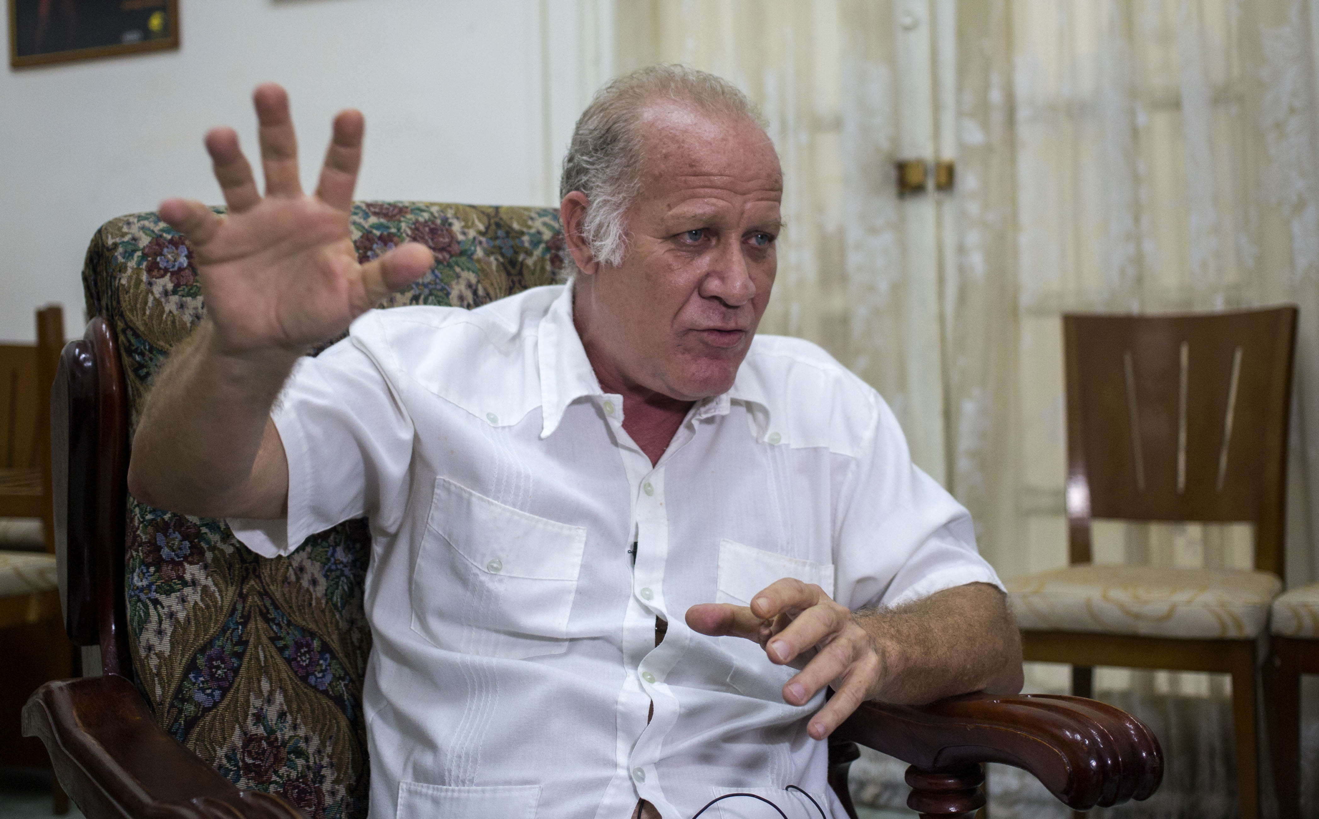 In this Dec. 4, 2018 photo, Vice Minister of Culture Fernando Rojas gives an interview in Havana, Cuba. Rojas says that Cuba is softening the impact of a heavily criticized new law that would have given government inspectors power to shut down any exhibition or performance deemed to violate the country's socialist revolutionary values. (AP Photo/Desmond Boylan)