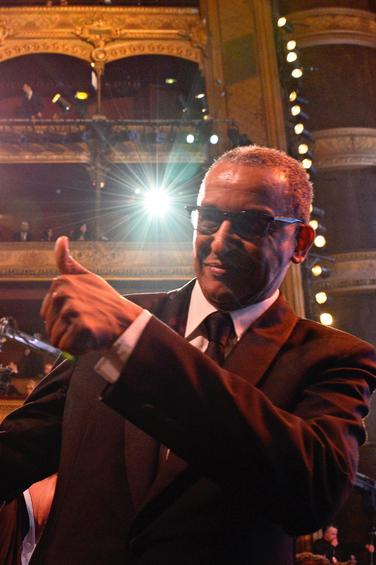 "Mauritanian director Abderrahmane Sissako gives the thumbs up after winning the Best Feature Film award for ""Timbuktu"" during the Cesar Awards ceremony on February 20, 2015 in Paris (AFP Photo/Bertrand Guay)"