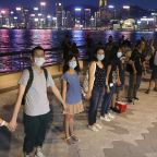 Thirty years on, Hong Kong is emulating a human chain that broke Soviet rule