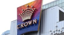 Crown shares dive as casino probe resumes