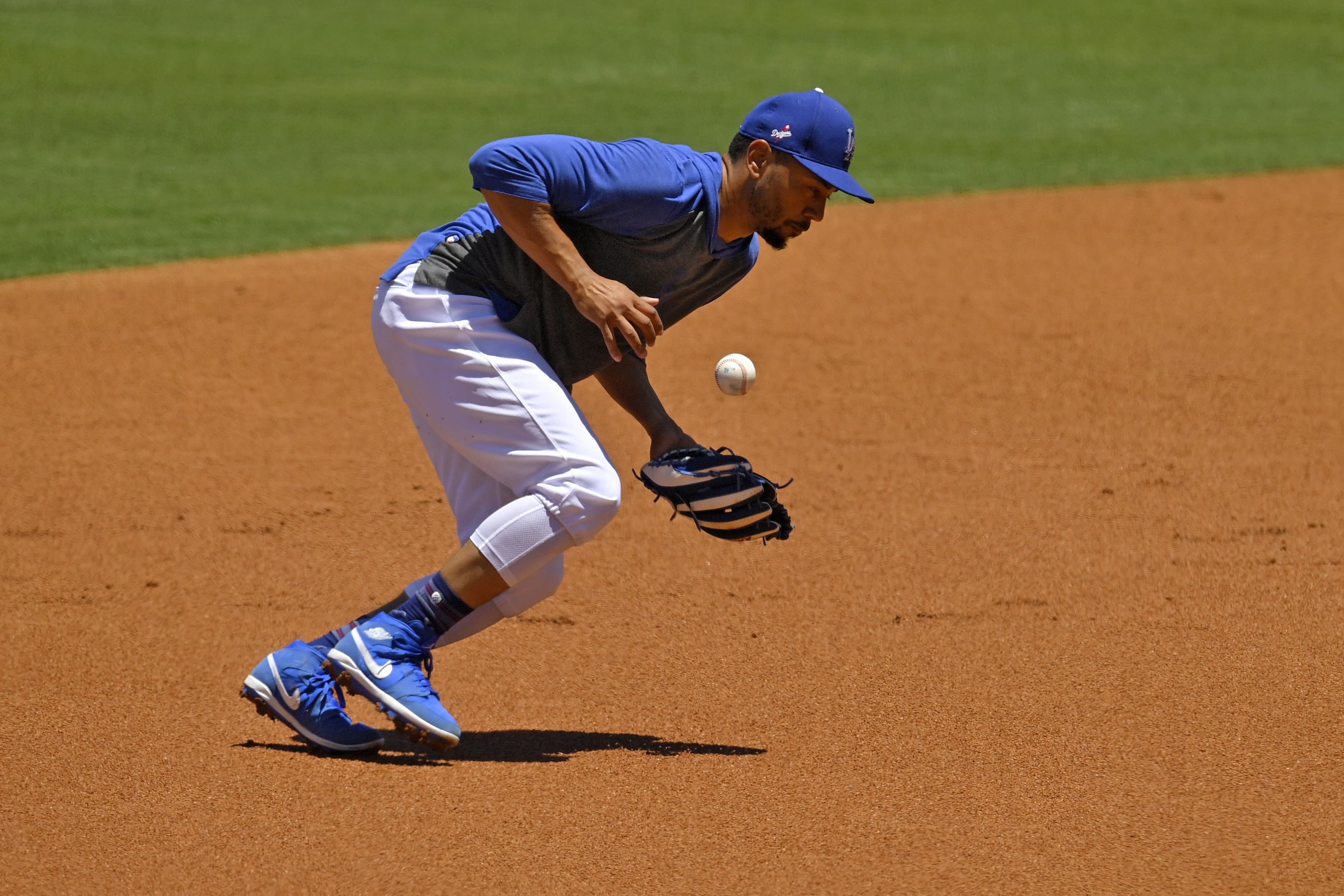 Los Angeles Dodgers right fielder Mookie Betts fields ground balls during the restart of baseball spring training Saturday, July 4, 2020, in Los Angeles. (AP Photo/Mark J. Terrill)