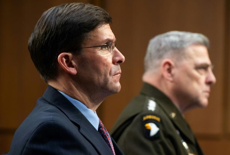 US Defense Secretary Mark Esper (L) and Chairman of the Joint Chiefs of Staff General Mark A. Milley say it could take several months to get back to normal from the coronavirus epidemic
