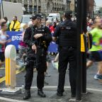 Police make fresh arrest as Manchester runners defy terror threat
