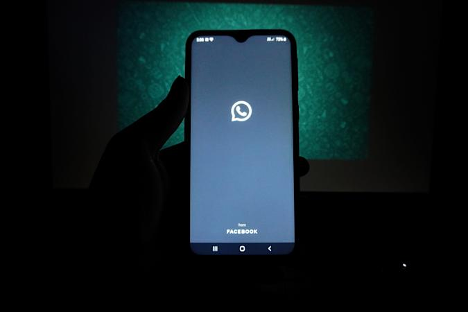 The logo of the messenger app WhatsApp is seen on the screen of a smartphone in New Delhi, India on May 27, 2021. WhatsApp has filed a legal complaint in Delhi against the government seeking to block regulations coming into force from Wednesday that experts say would compel the California-based Facebook unit to break privacy protections, according to Reuters sources. (Photo by Mayank Makhija/NurPhoto via Getty Images)