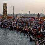 India's daily virus infections are world's highest but crowds gather for festival