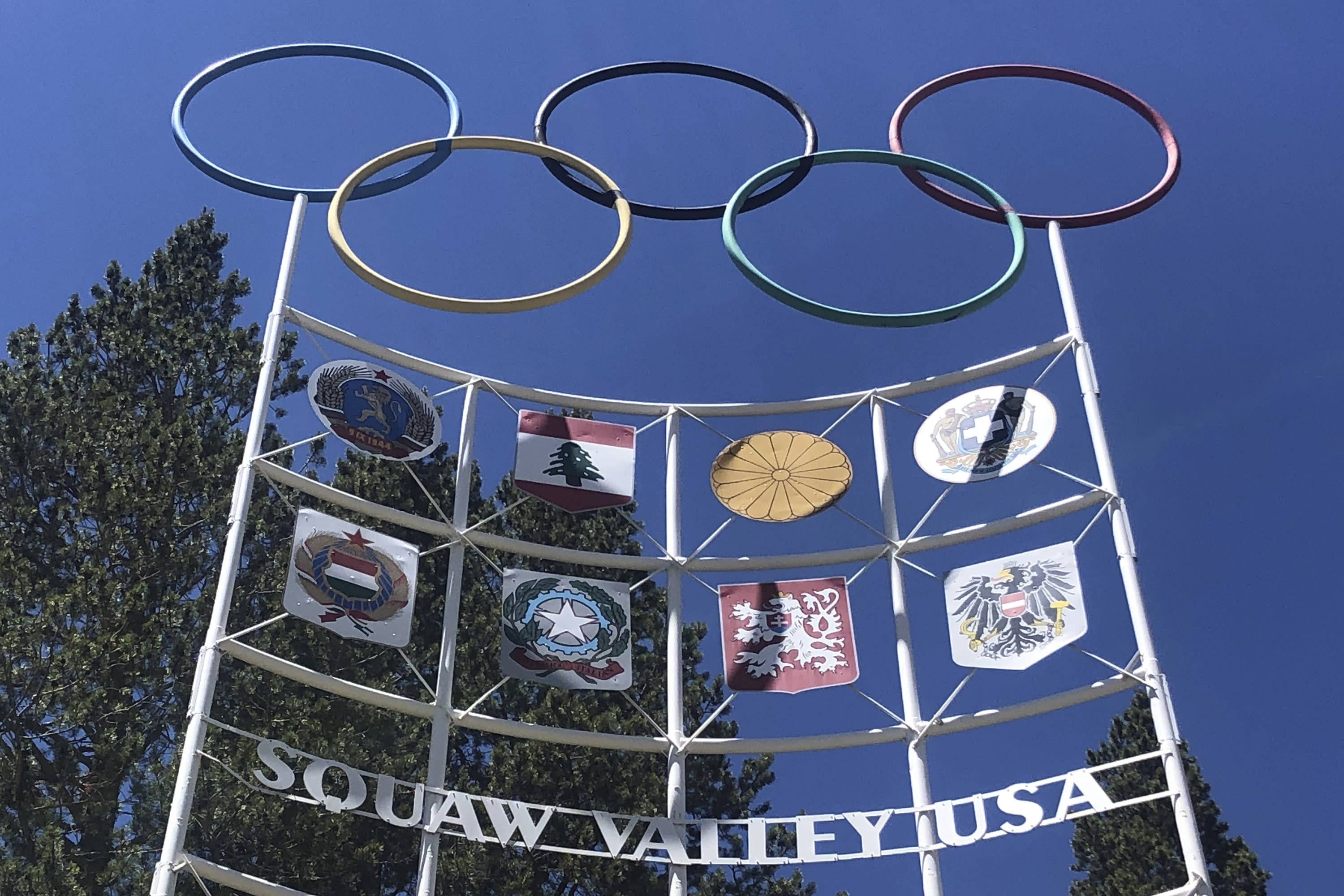 "FILE In this July 8, 2020 file photo, the Olympic rings stand atop a sign at the entrance to the Squaw Valley Ski Resort in Olympic Valley, Calif. Officials announced Tuesday, Aug. 25 California's popular Squaw Valley Ski Resort will change its name because the word ""squaw"" is a derogatory term for Native American women. The site was the scene of the 1960 Winter Olympics. (AP Photo/Haven Daley,File)"