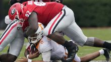 No. 3 Georgia uses swarming defensive effort to storm back and beat No. 14 Tennessee