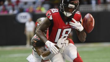 The Latest: Falcons WR Ridley injures ankle against Bucs