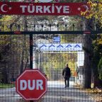 The Latest: Germany detains 7 people deported by Turkey