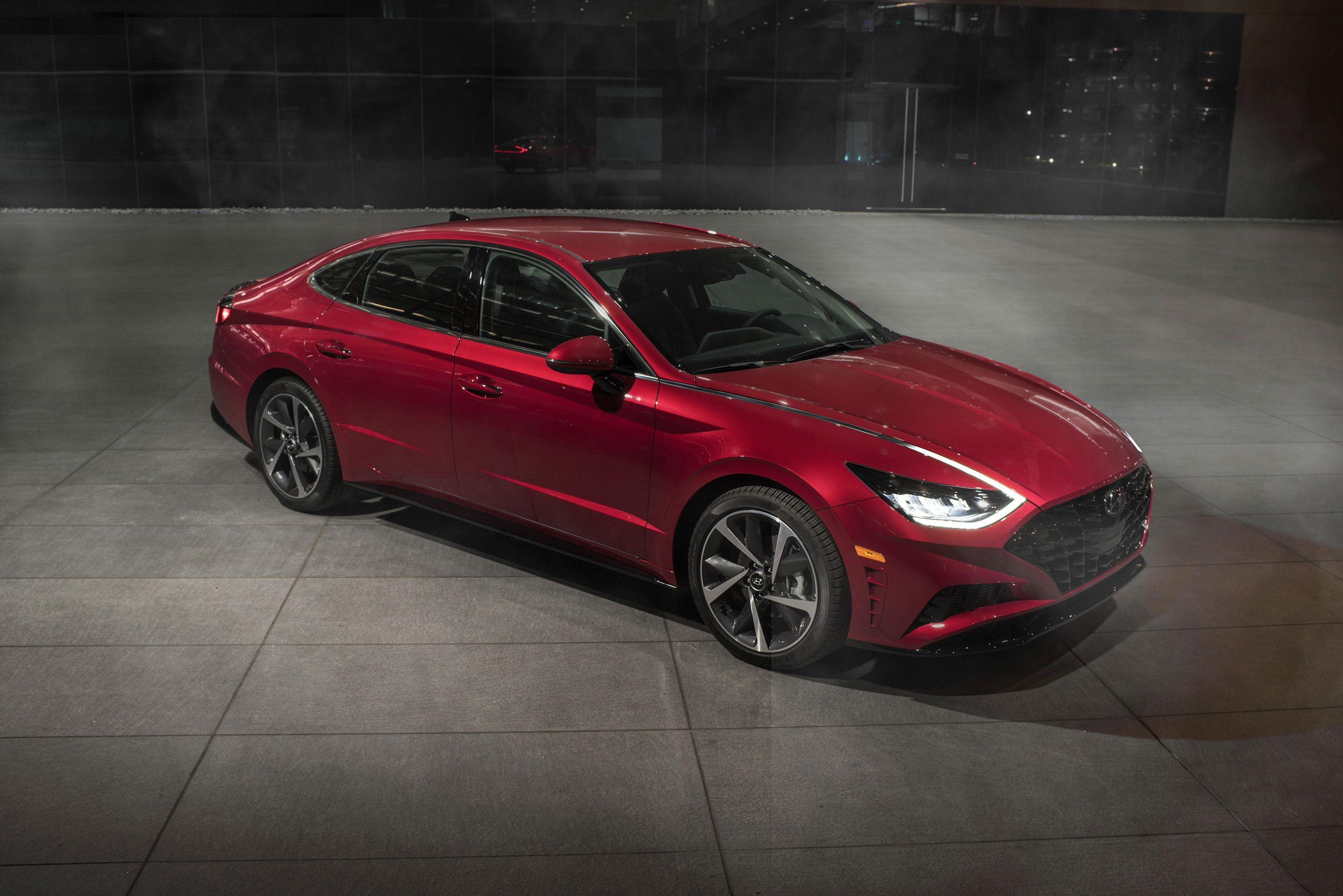 """<p>Gazing upon <a href=""""https://www.caranddriver.com/hyundai/sonata"""" rel=""""nofollow noopener"""" target=""""_blank"""" data-ylk=""""slk:the new 2020 Hyundai Sonata"""" class=""""link rapid-noclick-resp"""">the new 2020 Hyundai Sonata</a> in person brings the design to life and makes the car's eighth-generation overhaul even more impressive than what we could gather from <a href=""""https://www.caranddriver.com/news/a26692381/2020-hyundai-sonata-photos-info/"""" rel=""""nofollow noopener"""" target=""""_blank"""" data-ylk=""""slk:its initial photos"""" class=""""link rapid-noclick-resp"""">its initial photos</a>. Every detail is dripping with artistic influence: the extremely low hood, the shapely roofline that's an inch lower than before, and the significant depth found in the body sides. The rear deck is shorter, the overall diameter of the tires slightly larger. From the side, two prominent creases playfully converge and then diverge again as they run from front to back.</p>"""