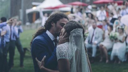 Bride and groom create epic music video in the pouring rain