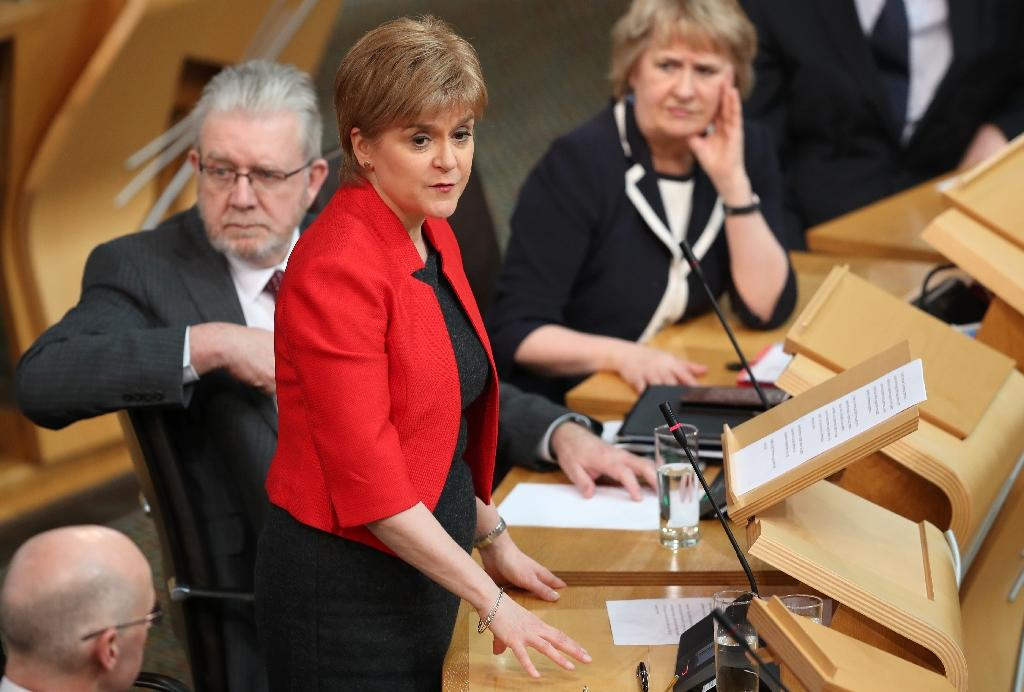 Scotland's lawmakers are due to back First Minister Nicola Sturgeon's (C) call for a second independence referendum when they vote in Edinburgh