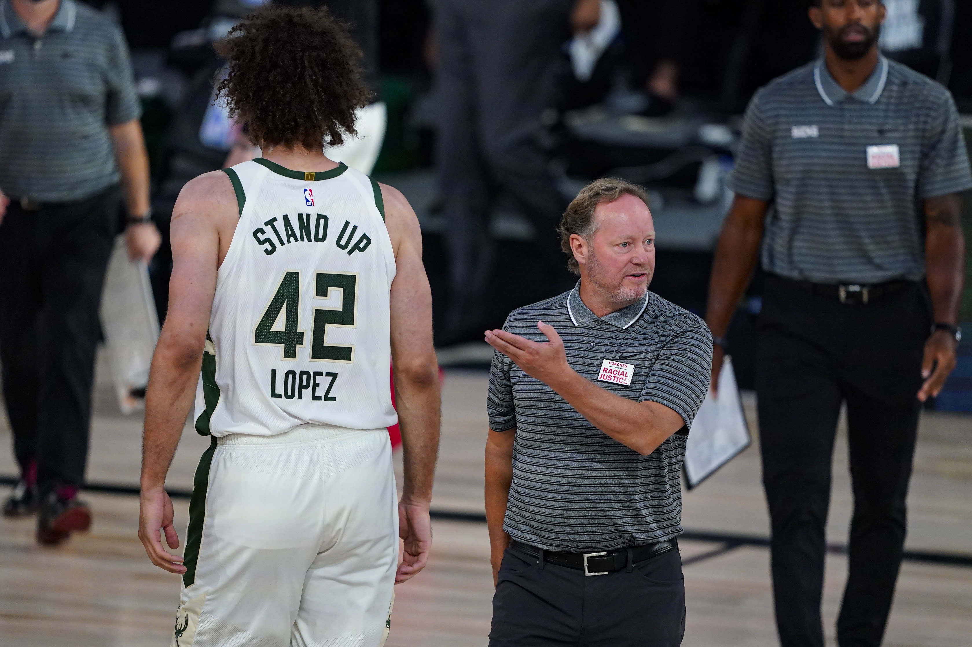 Milwaukee Bucks head coach Mike Budenholzer questions an official during the second half of an NBA basketball game against the Brooklyn Nets Tuesday, Aug. 4, 2020 in Lake Buena Vista, Fla. (AP Photo/Ashley Landis)
