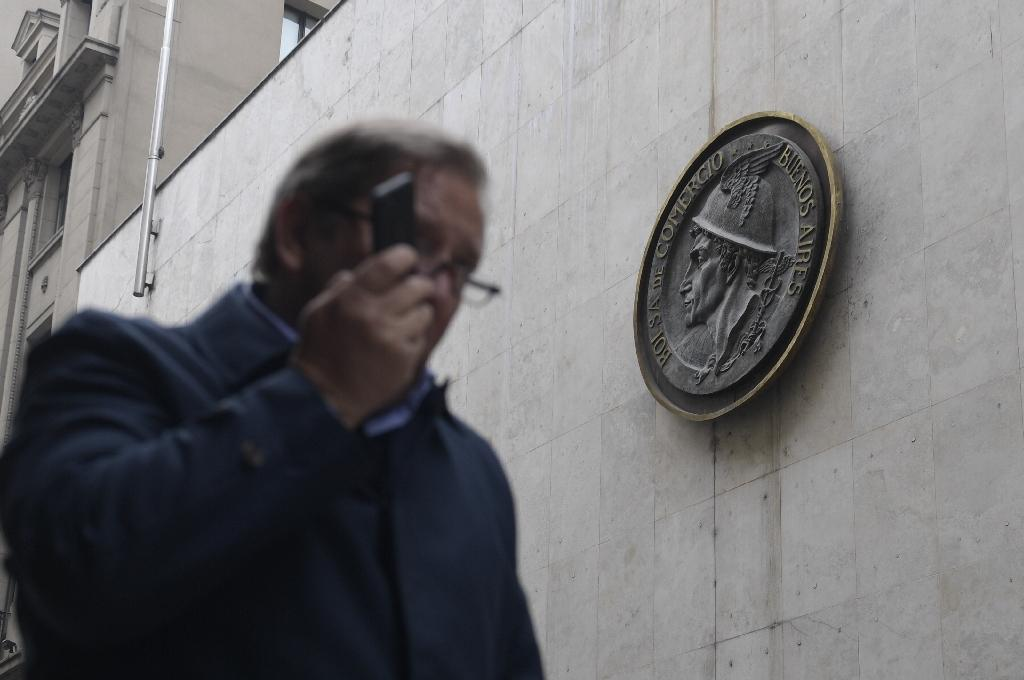 A man speaks on his mobile phone as he walks past the Buenos Aires Stock Exchange on September 3, 2018, a day in which Argentine President Mauricio Macri announced sweeping austerity measures (AFP Photo/Juan MABROMATA)
