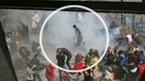 Photos of Boston Bombing Show Man Running