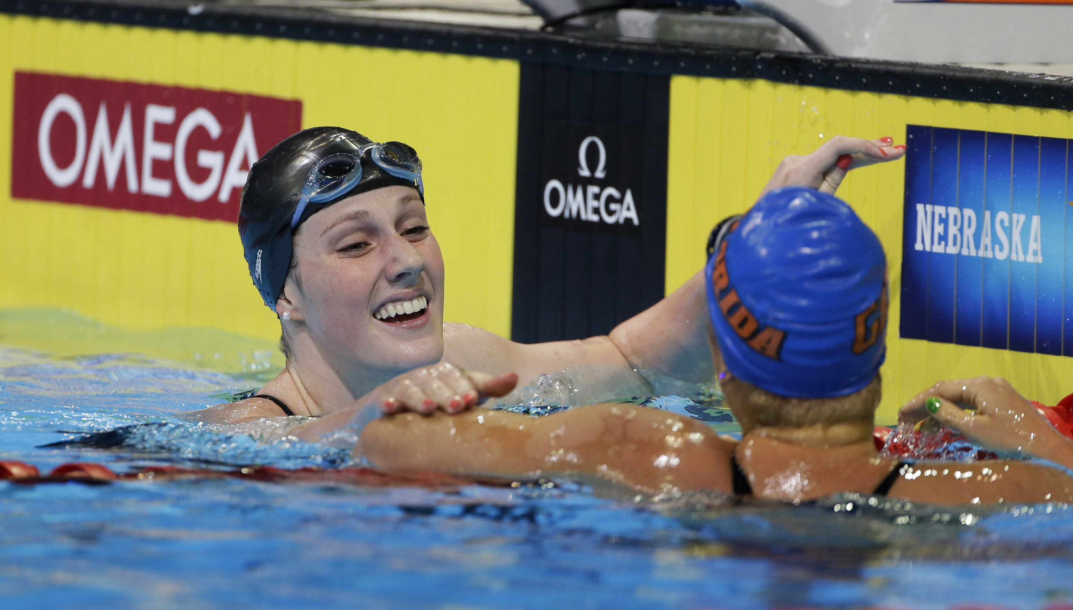 Missy Franklin smiles with Elizabeth Beisel, right, after swimming in the women's 200-meter backstroke final at the U.S. Olympic swimming trials on Saturday, June 30, 2012, in Omaha, Neb. (AP Photo/Mark Humphrey)