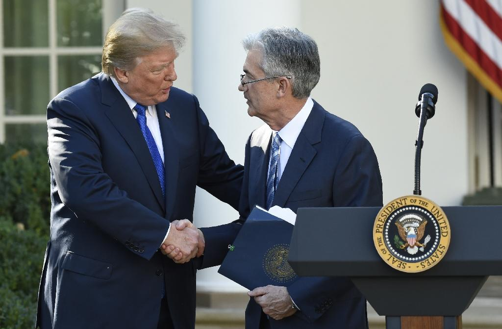"US President Donald Trump (L) said it was ""too early to say"" if he regretted nominating Jerome Powell (R)"