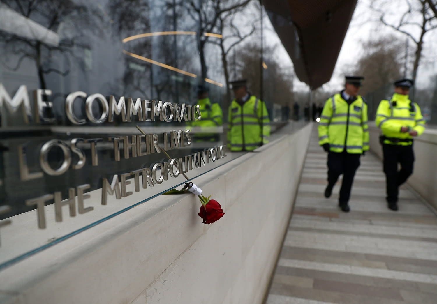 <p>A floral tribute is shown outside New Scotland Yard following Wednesday's attack outside the Houses of Parliament in London, Friday, March 24, 2017. (Peter Nicholls/Reuters) </p>