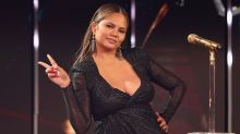 Chrissy Teigen Shows Off Bare Baby Bump During Lazy Weekend -- See the Pic!