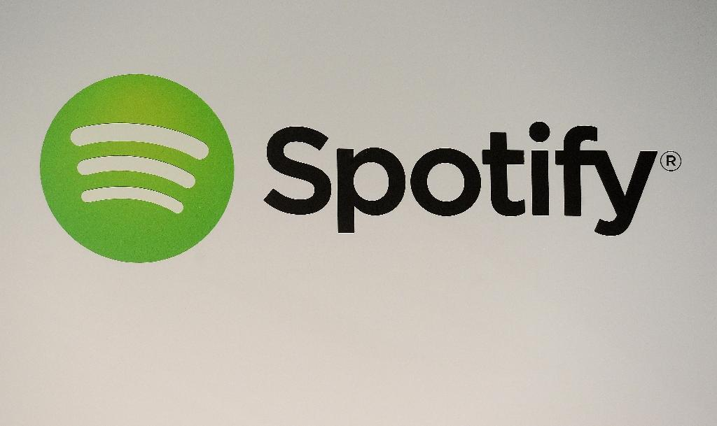 Warner Music has sold its share in Spotify and says it will give back part of what it earned to artists on its labels