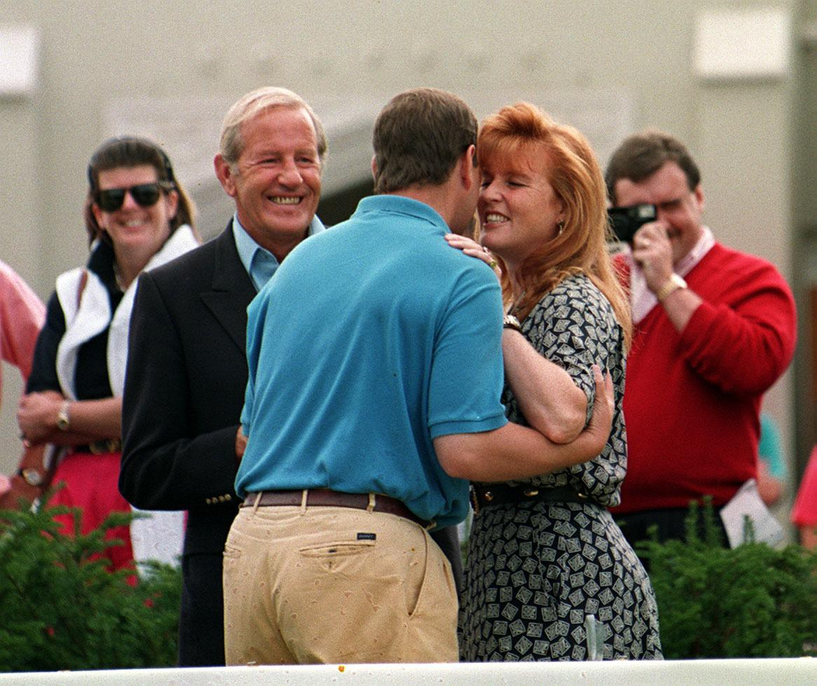 The Duke of York gives his wife a kiss at Wentworth golf club where he took part in a pro-am golf tournament in aid of motor neuron disease association- of which the Duchess of York is president.