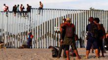 Caravan migrants reach US border