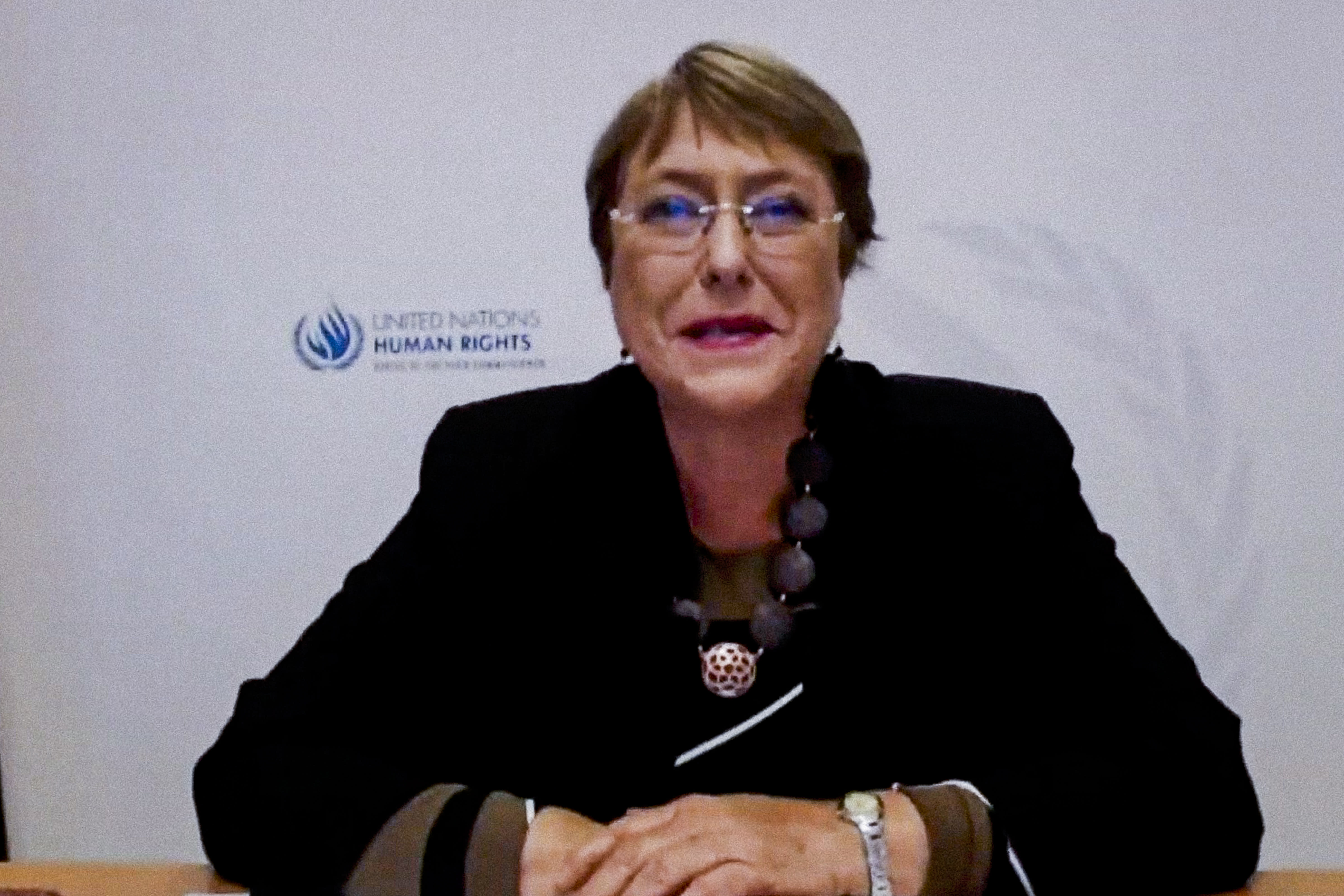 """In this photo provided by the United Nations, Michelle Bachelet, U.N. High Commissioner for Human Rights, addresses the high-level virtual panel entitled """"Participation, Human Rights and the Governance Challenge Ahead,"""" Friday, Sept. 25, 2020, in New York. (Manuel Elias/United Nations via AP)"""
