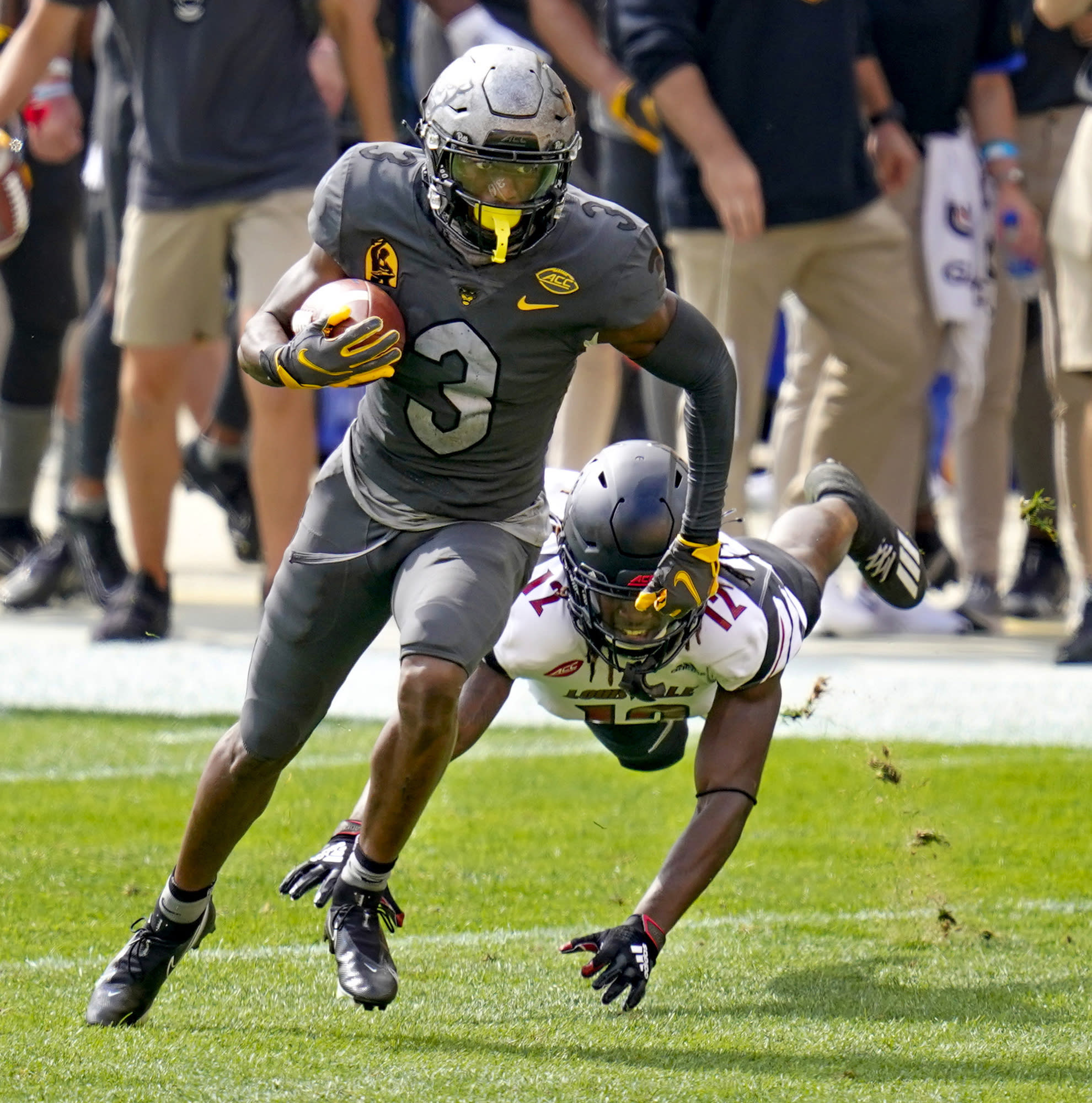 Pittsburgh wide receiver Jordan Addison (3) gets past a diving Louisville linebacker Dorian Etheridge (17) during the first half of an NCAA college football game, Saturday, Sept. 26, 2020, in Pittsburgh. (AP Photo/Keith Srakocic)