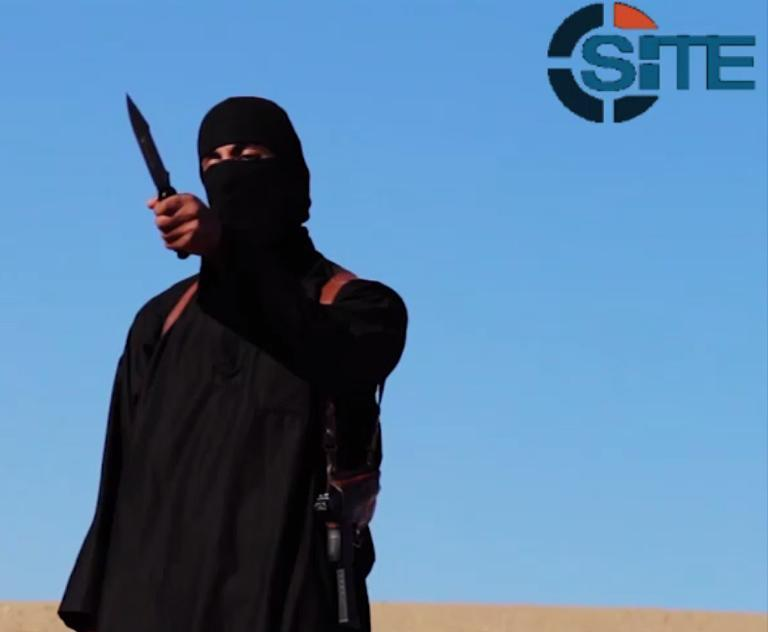 An image grab taken from a video released by the Islamic State and identified by SITE Intelligence Group on September 13, 2014 purportedly shows a masked militant before beheading British aid worker David Haines