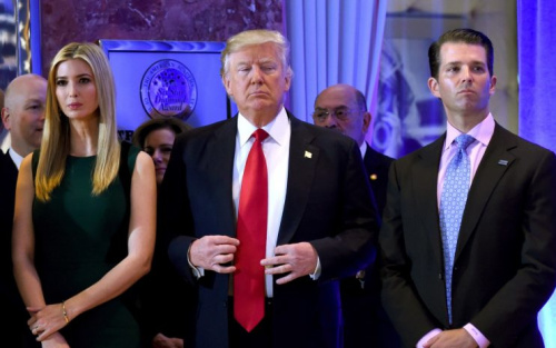 President- elect Donald Trump stands with his children Ivanka and Donald Jr., during Trump's press conference at Trump Tower in New York on Jan. 11, 2017.