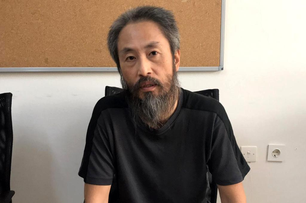 Journalist Jumpei Yasuda has faced hostility from fellow Japanese since arriving back home after spending three years in captivity in the Middle East (AFP Photo/Huseyin BOZOK)