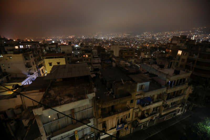Buildings are seen at night during a power cut in some areas in Beirut