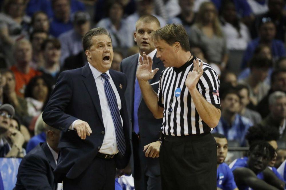 John Calipari argues with referee John Higgins over a call during Kentucky's 75-73 loss to North Carolina. (AP)