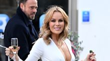 Amanda Holden wows fans by posing naked on a pile of money