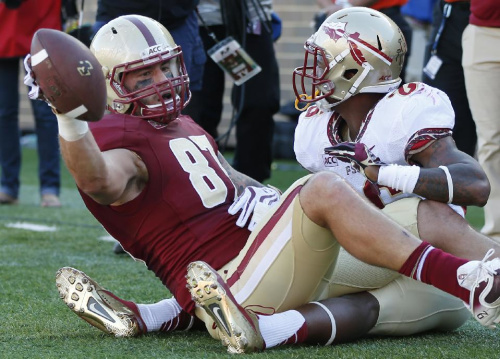 Boston College tight end C.J. Parsons (87) holds up the football after his leaping touchdown catch against Florida State defensive back P.J. Williams, right, during the first quarter of an NCAA college football game at Alumni Stadium in Boston, Saturday, Sept. 28, 2013
