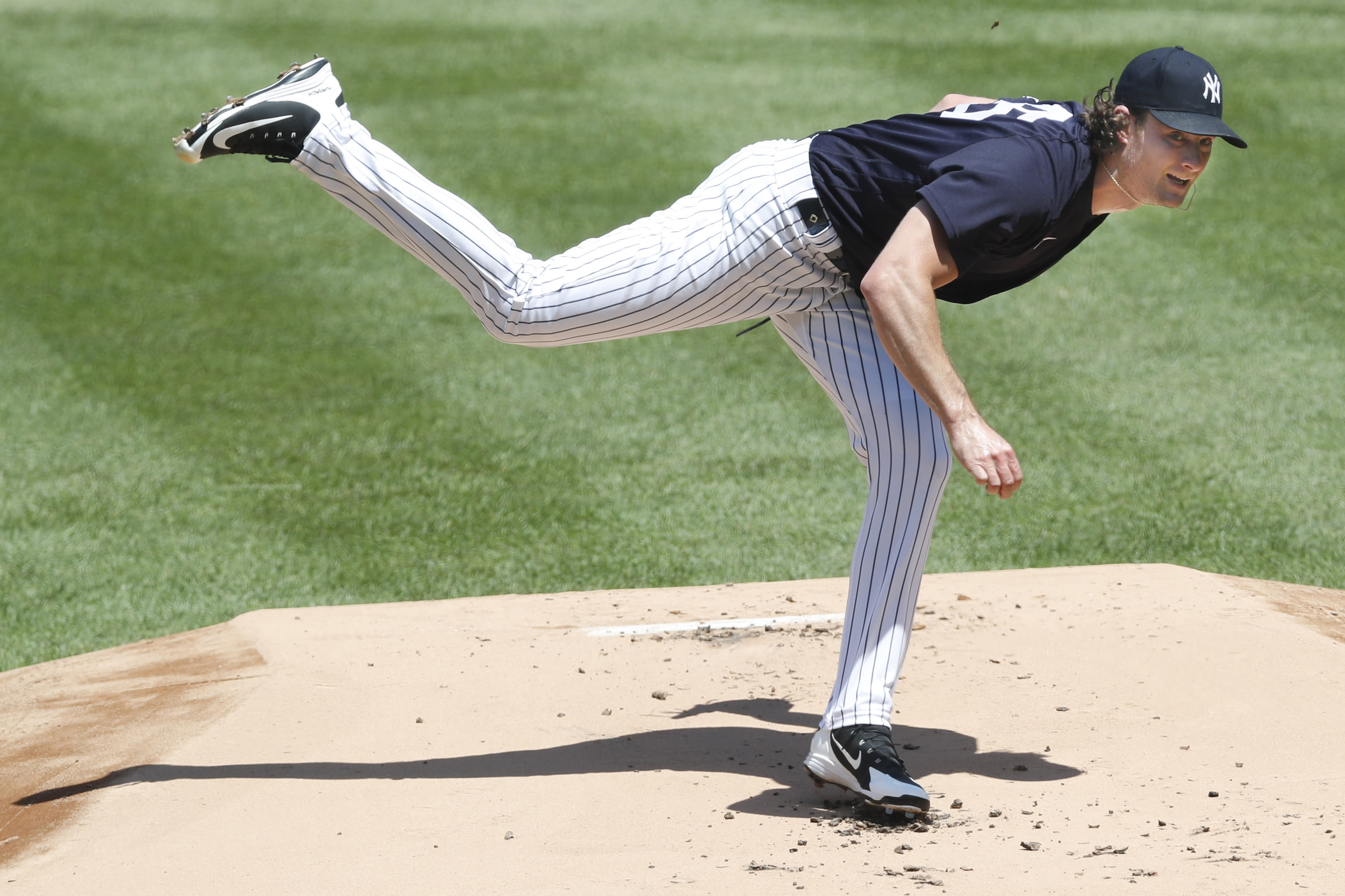 FILE - In this Sunday, July 12, 2020, file photo, New York Yankees starting pitcher Gerrit Cole follows through on a pitch during an intrasquad baseball game at Yankee Stadium in New York. On Thursday, July 23, the Yankees play at the Washongton Nationals. Juan Soto and Washington open their title defense after winning the World Series for the first time in franchise history. Gerrit Cole is hoping to lead New York to its 28th championship after the ace right-hander signed a blockbuster deal with the Yankees in free agency.(AP Photo/Kathy Willens, File)