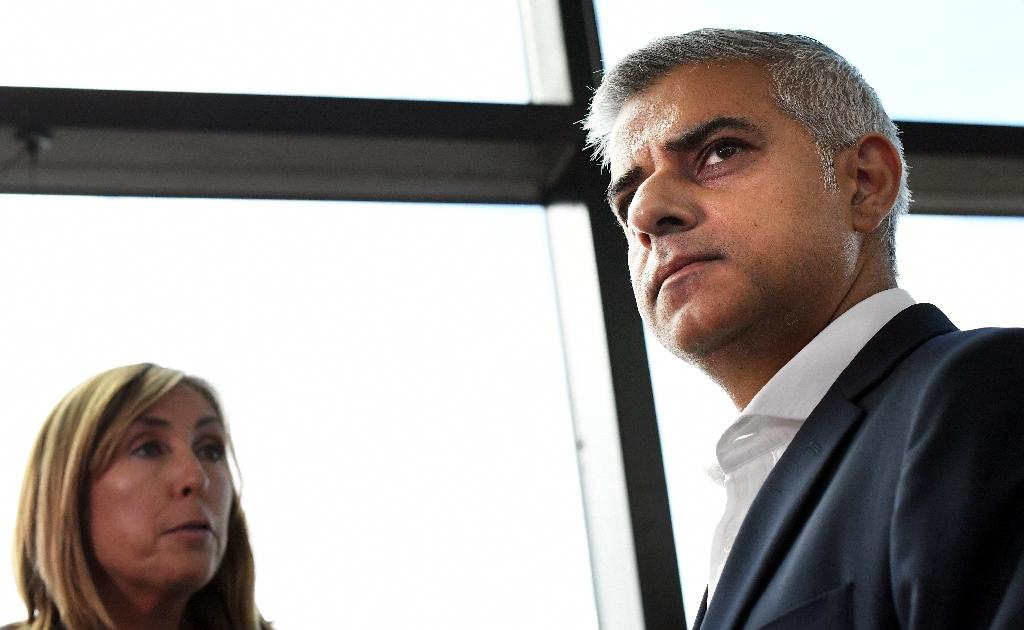 Mayor of London Sadiq Khan (R) waits to give a television interview during the annual Labour Party conference in Liverpool, England on September 27, 2016