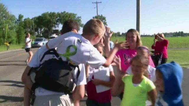 Teen walks 40 miles carrying brother to raise awareness for cerebral palsy