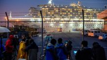 Japan keeps high coronavirus alert as more citizens return from China
