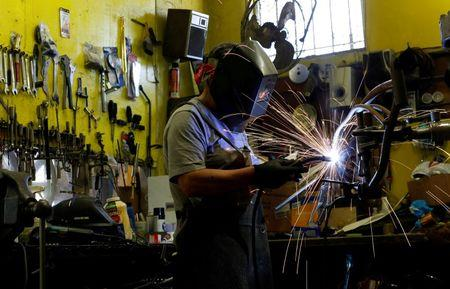 Manny Silva welds in his bike shop which specializes in customized low rider bicycles, in Compton, California U.S., June 3, 2016. Picture taken June 3, 2016. REUTERS/Mario Anzuoni