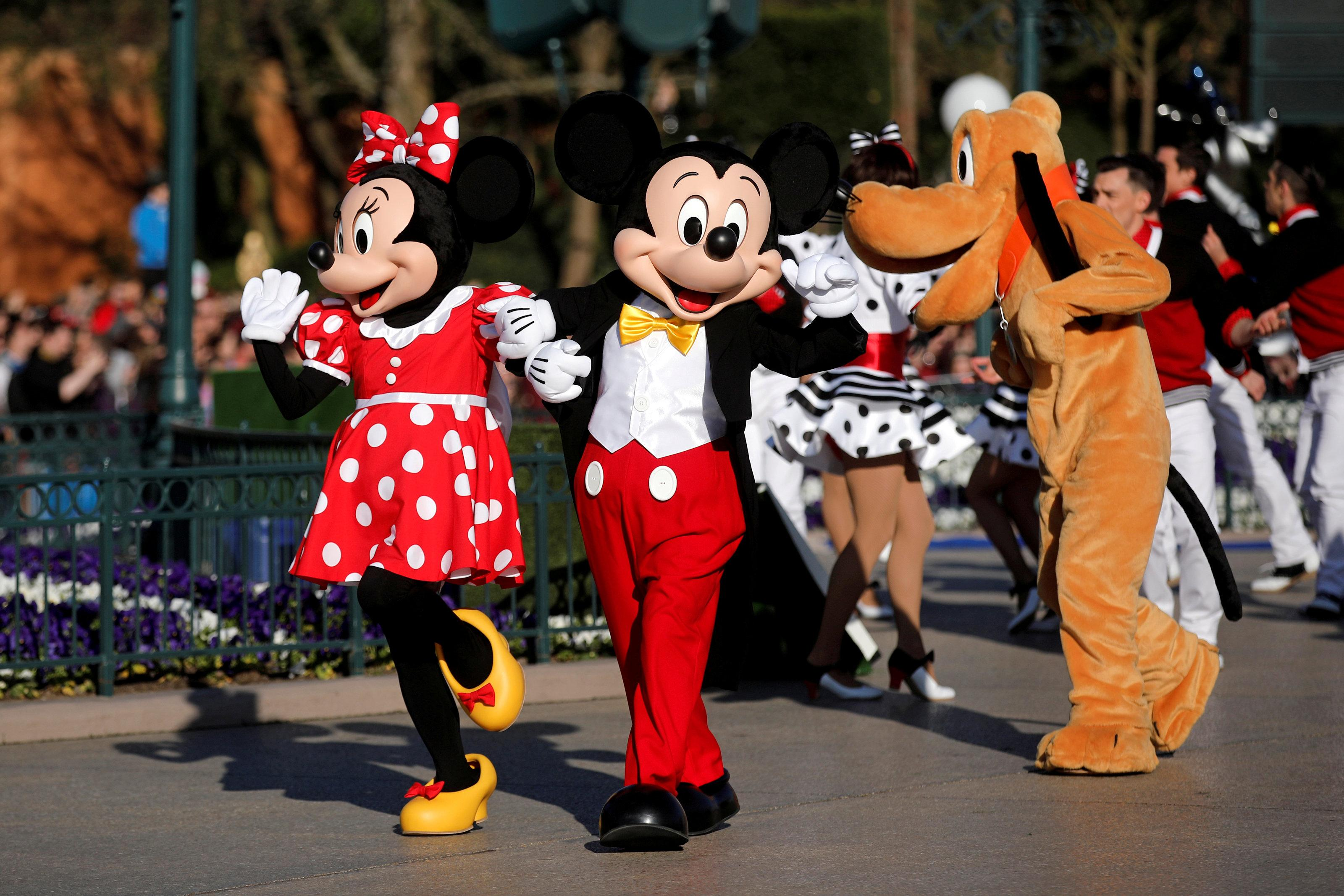 Disney soars past expectations, shares climb