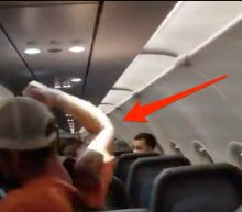 Video shows a Frontier passenger being duct-taped to his seat after punching and groping flight attendants, screaming obscenities, and walking around the plane shirtless