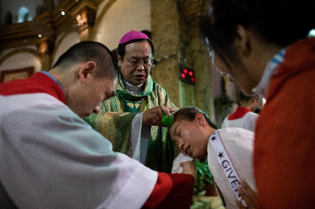 Those with links to the unofficial church say it appears the Vatican is making concessions to China in hope of better relations (AFP Photo/Nicolas ASFOURI)