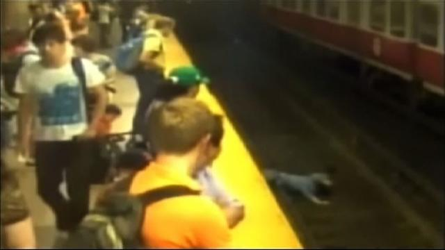 Woman falls onto train tracks with child