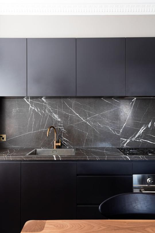 """<p>Black and white kitchens are never going out of style, <a href=""""https://www.yahoo.com/makers/buh-bye-white-kitchens-dark-080116788.html"""" data-ylk=""""slk:but kitchens in 2016 are going heavy on the black and light on the white;outcm:mb_qualified_link;_E:mb_qualified_link"""" class=""""link rapid-noclick-resp yahoo-link"""">but kitchens in 2016 are going heavy on the black and light on the white</a>. These dramatic kitchens are perfect for creating a high impact in a small space, or grounding a larger space. Avoid the traditional, sterile look of a white kitchen, and get in on the """"kitchen noir"""" trend. <i>(Photo: <a href=""""http://www.tfad.com.au/235489/7016146/gallery/potts-point-apartment"""" rel=""""nofollow noopener"""" target=""""_blank"""" data-ylk=""""slk:TFAD"""" class=""""link rapid-noclick-resp"""">TFAD</a>)</i></p>"""