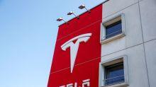Tesla taps brake on massive stock rally